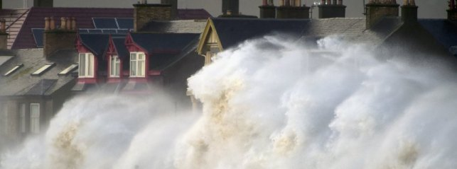 PRESTWICK, UNITED KINGDOM - DECEMBER 10:  Waves crash against the promenade wall on December 10, 2014 in Prestwick, Scotland. High winds and large waves hit the North West Coast of the UK and Northern Ireland today  (Photo by Jeff J Mitchell/Getty Images)